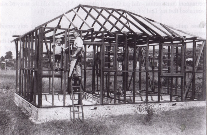 My father and myself, the frame of the bungalow is complete, about 1935