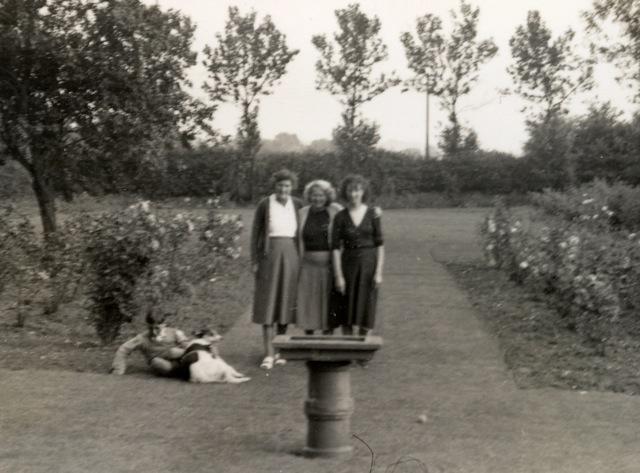 Cranleigh garden - left to right: Bother Peter, Boko (my beloved dog), then Isobel (mother's friend), Dragitza (Yugoslav relative) and mother. | John Geogiadis