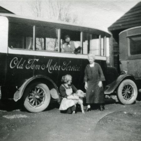 Old Tom Motor Services with family in yard.   Ann and John Rugg.