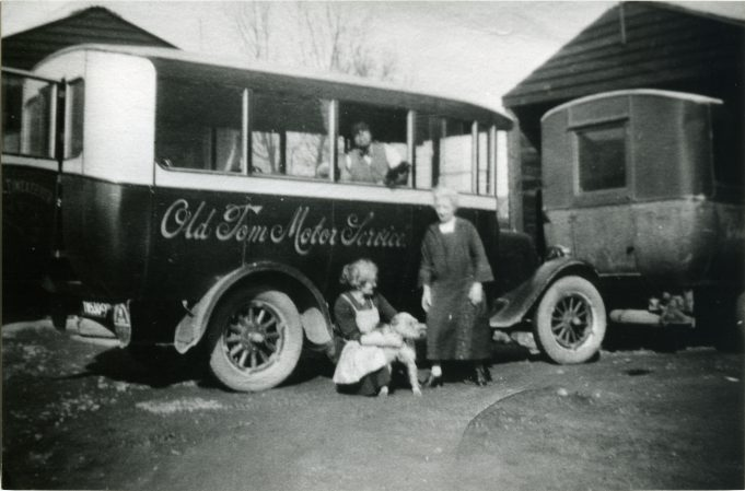 Old Tom Motor Services with family in yard. | Ann and John Rugg.