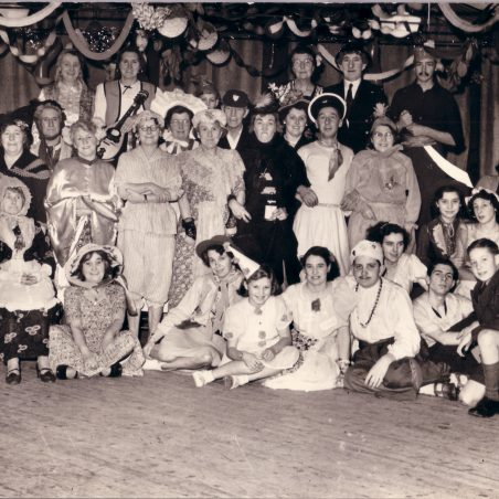 Was this a pantomine, variety show or fancy dress party?  Unfortunately the photo is undated.