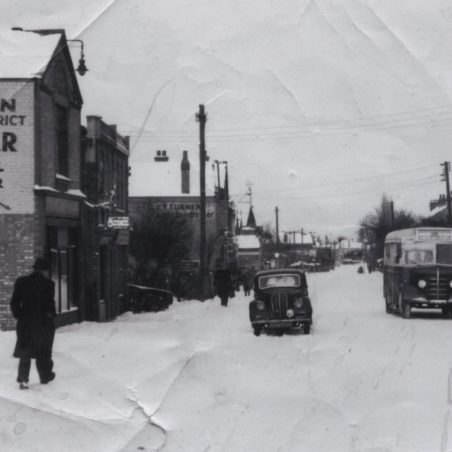 City Coach Company vehicle passing Laindon Recorder office in High Road, Laindon.   Ann and John Rugg.