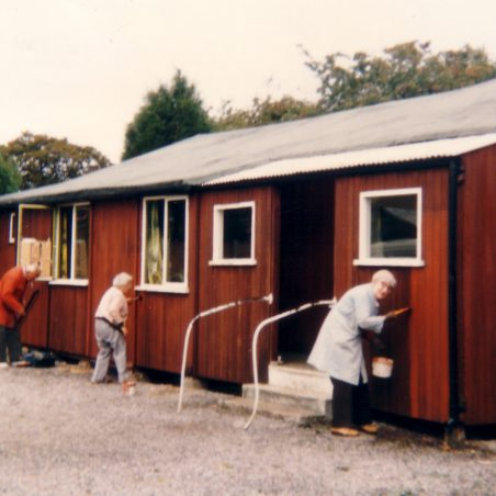 Painting the outside of the hall.
