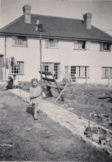 September 1948 Grandad's path taking shape with early experimental wind turbine. The brick base is still there and in use, but the wind turbine was not successful | Patsy Mott (née Tyler)