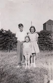 1950 We three in Aunt's garden at