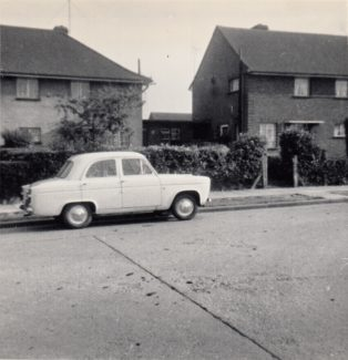 June 1964 Dads Ford Prefect outside No 15 with privet hedge and Hawthorne tree getting larger | Patsy Mott (née Tyler)