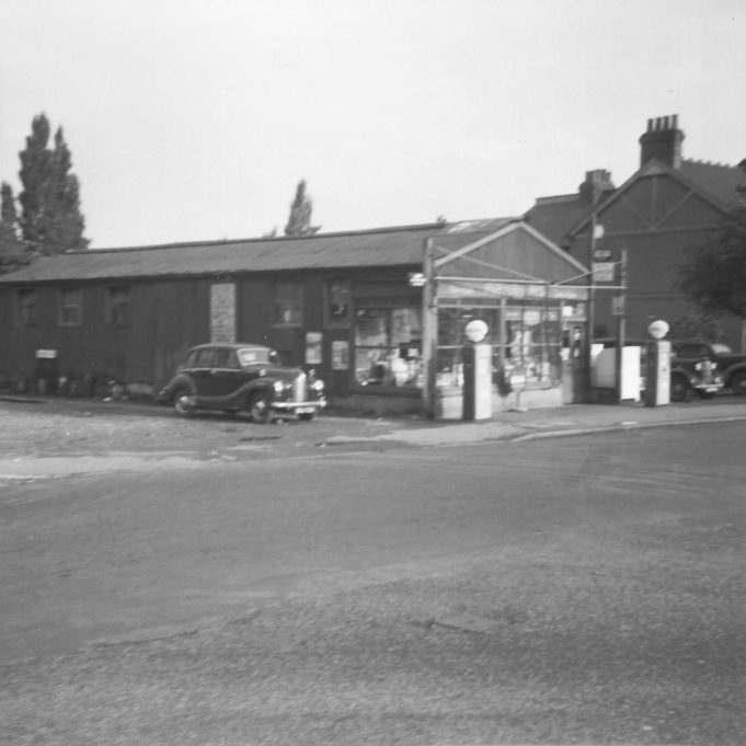 Parkinson's old garage on the corner of Somerset Road. In yard FX3 Austin taxi and 1937 Chrysler taxi. My uncle Reg's Austin A40 Devon for sale in Somerset Road.