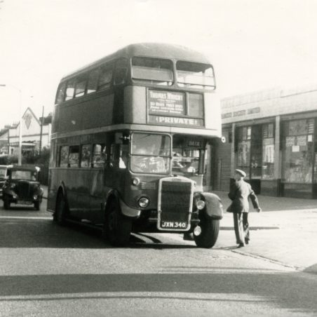 JXN340 - Ex London bus operating for Thomas Wright, on works outing, pausing outside Grays Co-operative stores in Laindon High Road 1957.   Ann and John Rugg.