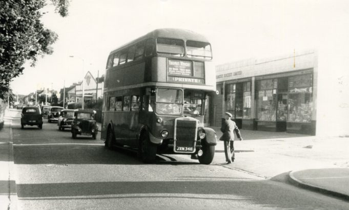 JXN340 - Ex London bus operating for Thomas Wright, on works outing, pausing outside Grays Co-operative stores in Laindon High Road 1957. | Ann and John Rugg.