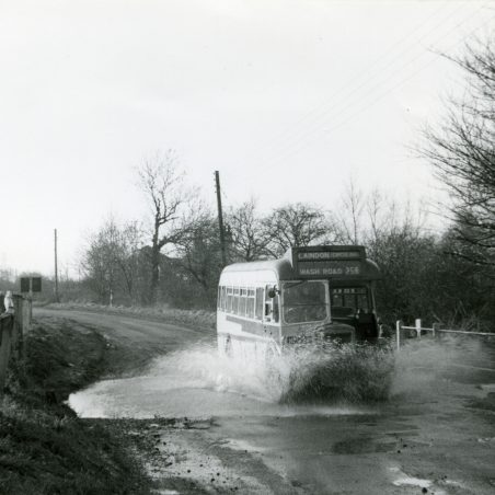 Eastern National bus on Service 258 splashing through the stream in Wash Road, Laindon (1959).   Ann and John Rugg.