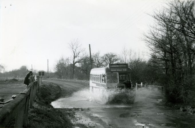 Eastern National bus on Service 258 splashing through the stream in Wash Road, Laindon (1959). | Ann and John Rugg.