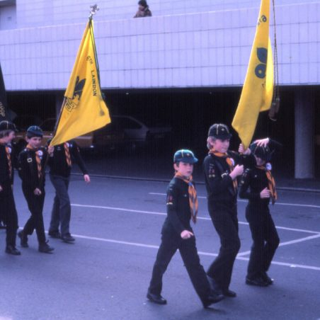 6th Laindon Cub Scouts.  St George's Day Parade 1982.  Mark Humphrey carrying the front flag.
