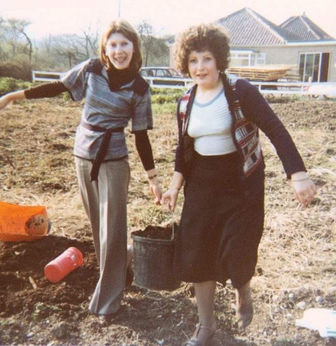 A heavy bucket of compost carried by Colin's sister Susan (left) and Maureen. | Nina Humphrey