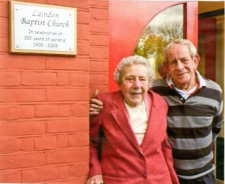 Hilda Kiddell and her brother Brian alongside the commemorative plaque at the Laindon Baptist Fellowship.