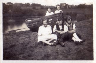 The boat and the pond in the field along side the farm. Rose Richards front left, Jimmy Richards in the middle, Lizzy Richards front right.  Viley Richards back left, back right - unknown. | Denise Hamilton.