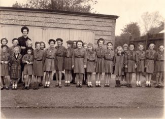 Brownie Pack outside Dr Long's garage. (Please click on the picture to enlarge) | Georgina Nottage (née Ellingford).