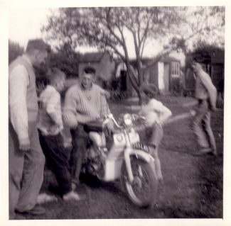 My brother Alan's first motorbike although it would be another four years before he could ride it on the roads.  My dad on the left.  Big brother Dennis sitting on the bike, Alan between them, Dennis's son Paul on the right.  Neighbour, Norman Whitehead on extreme right.