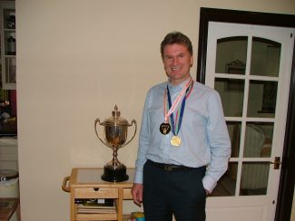 Eamonn with his Marathon Cup and two of his many medals. Commonwealth Gold and 10,000m Oslo 1988.