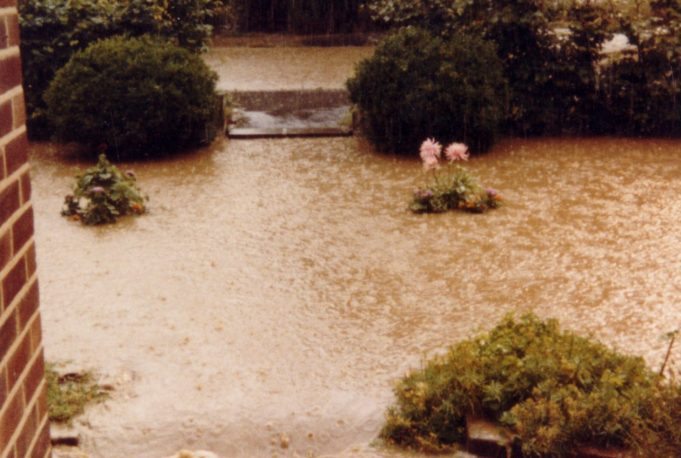 Scene from the door step.  Front garden had disappeared below the water.  Kennel Lane in the background. | Nina Humphrey