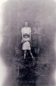 Coping without Dad - 1944.   Mum, Dennis, Anne and a huge haystack. | Nina Humphrey