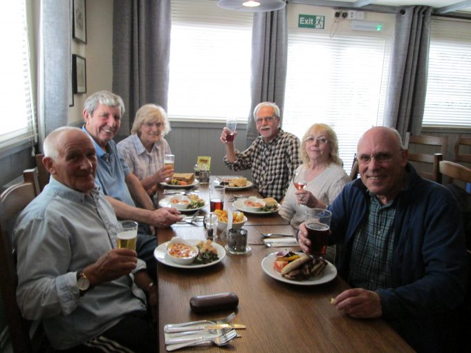 Lunch at The Old Dog. From left, Chris Ash, Alan Davies, Nina Humphrey (née Burton), Colin Humphrey, Andrea Ash (née Pinnell) Jim Grindle. | Waitress in The Old Dog.