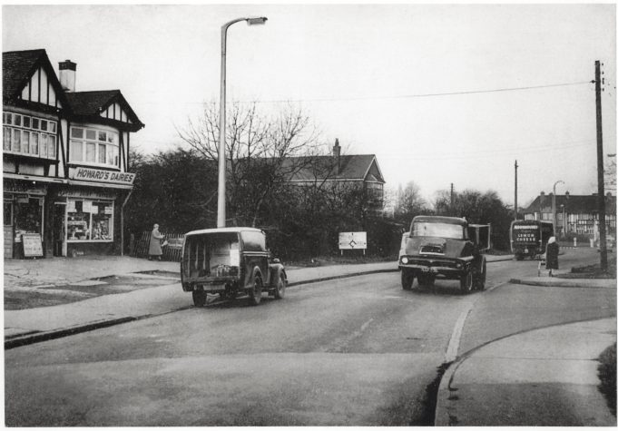 School parade on the left, Wiseman's (just out of sight), Weedon's and Howard's Dairies.  Buckenham's butcher further along. | Barry Ellerby