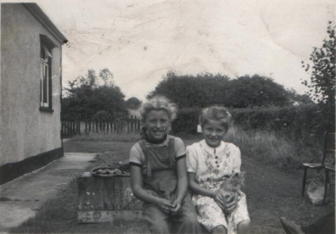 13.  Orange boxes being used as garden furniture 1955. Nina and cousin Joan in the garden of Pendennis. | Nina Humphrey