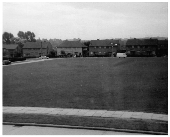 Looking across to the junction between Briar Mead and Powell Road. This photo of the playing field in King Edward Road was taken from 40A, before Royal Court was built. We kids used to ride our bikes around the block, as we called it, or play games such as rounders and the boys played football. | Pam Quarman