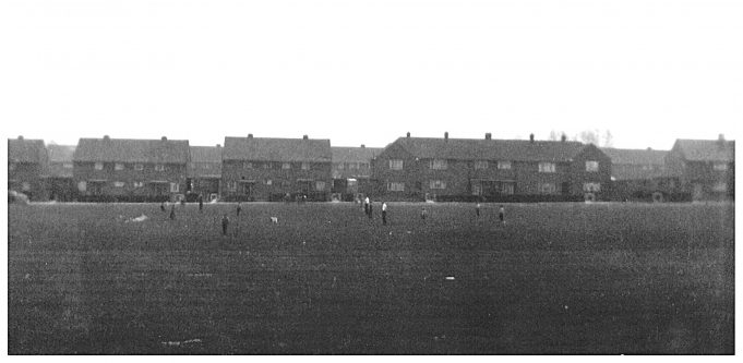 Looking across to Powell Road with Dads supervising the children at play. This photo of the playing field in King Edward Road was taken from 40A, before Royal Court was built. We kids used to ride our bikes around the block, as we called it, or play games such as rounders and the boys played football. | Pam Quarman