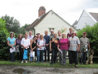 From the left:  Jean, Cheryl, Brenda, Paul, Susan, Colin, Nina, Dave, Ricky, Anne, Vivienne, Andrea, David, Chris, Trevor and Reba the dog in front of Hall Farm Cottage.