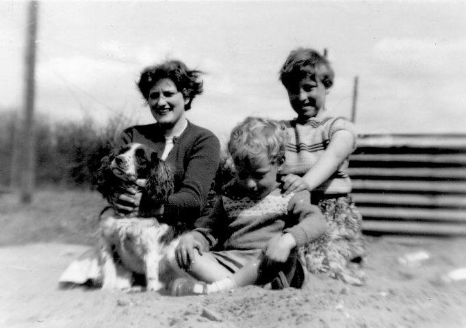 12.  Anne, Nina, Alan and dog Curly, in the sandpit. 1955. | Nina Humphrey