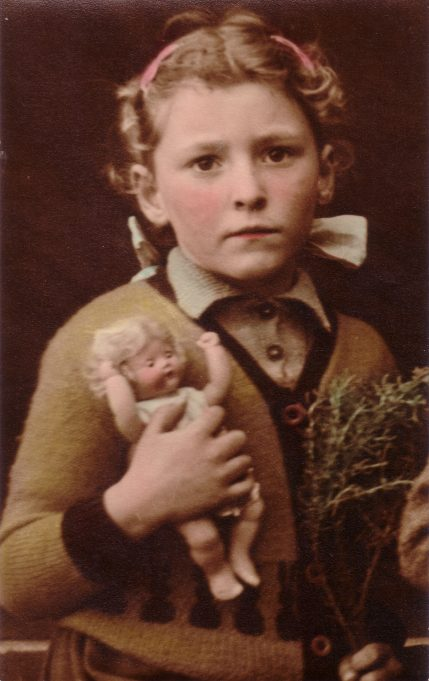 My first school photo.  Aged 5 1951.  My mum wasn't keen on this one because she thought I looked a bit scared. I was wearing one of her knitted cardigans with little bunny rabbits around the waist - very fashionably at that time.   Nina Humphrey