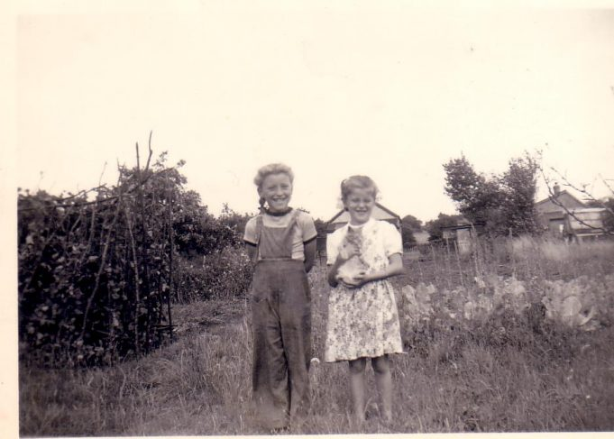 Nina and Joan in the back garden of 'Pendennis' Alexandra Road, Laindon. 1954.  The back of 'Rosedene' to the right of the photo. | Nina Humphrey.
