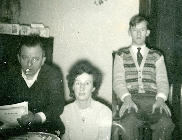 1955-Father, mother and me (must have been a first attempt and automatic flash photography, judging by the startled looks!) | John Geogiadis