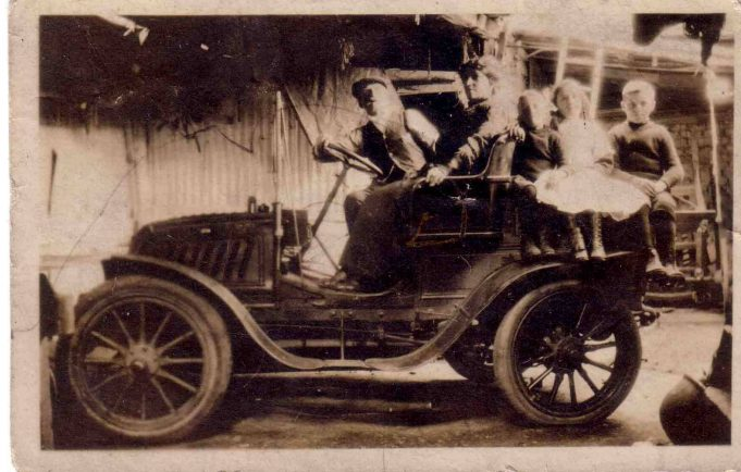 Photo of my Grandma Amy Burton, with her children, George (my dad) and the twins, Cyril and Gladys, taken sometime between 1912 and 1915 in London shortly before Amy inherited the plot of land in Laindon.  I think the driver may be James Burling, the man who she worked for as 'housekeeper'.  He died in 1915, leaving everything to her in his will.  If that hadn't have happened, my dad would never have come to Laindon and met and married my mum and I wouldn't be here to tell the tale. | Nina Humphrey(née Burton)