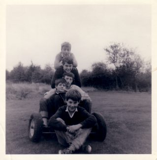 Our go-cart, made by my brother Dennis.  From bottom.  Martin Burton, Paul Burton, Alan Burton and friends Ray Thomas from Bourne Close and David Whitelock from the Kathleen Ferrier estate.