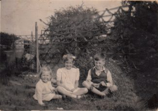 1947 Me, Joyce and Don in back garden of