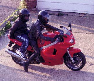 My nephew Paul Burton on his Triumph with a small pillion passenger 2005.