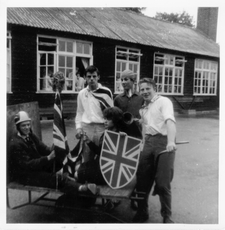 Leaving day parade on the school's milk trolley, outside the wooden buildings.  From left sitting.  Tony Trew and Joan Hewett.  Standing. Graham Godward, John Bird and Philip Thomas | Nina Humphrey(née Burton)