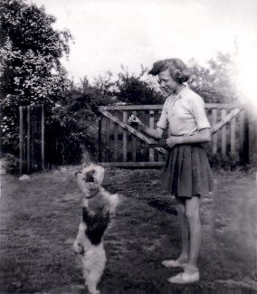Teenage Sylvie with Flossie in garden of Artillery View. | Sylvie Currington.