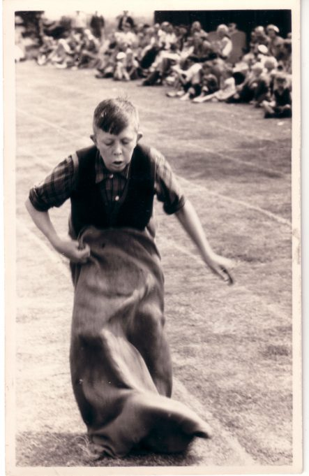 My brother Robin, age 13 in a sack race at Laindon High Road School sports (early fifties). | Judith Howgego (née Dutnall)