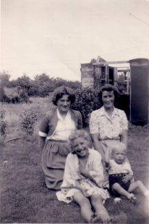 The remains of Dad's walk-in rabbit shed in the background. Me front left with brother Alan. Sister Anne behind me with our Mum, Jessica. 1954. | Nina Humphrey