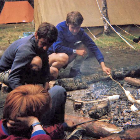 6th Laindon Scout Troop toasting 'dough balls' over the camp fire.  Summer camp, Thetford, Norfolk approx. 1985/86.  Ernie Easterby and David Vann facing the camera.