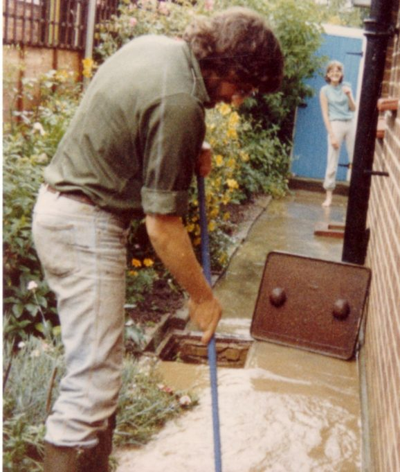 Trying to guide the water down the drain and away from the bungalow in Kennel Lane.   Nina Humphrey