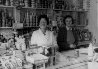 My mother Mabel and shop assistant Lydie in Manor Dairy | Peter Sloper