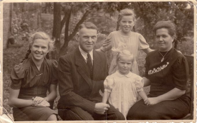 Wilhelm (surname unknown) the German Prisoner of War with his wife and three daughters. | Jill Barnes (née Adams)