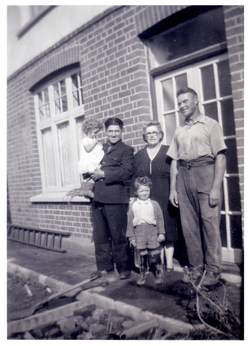 Jill with Jacob, the Polish workman, her brother Michael and grandmother, Lilly Bailey. On the right, Wilhelm, the German Prisoner of War. | Jill Barnes (née Adams)