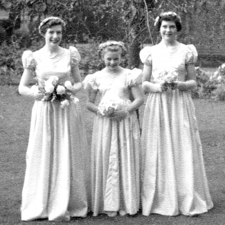 Winifred Archibald (centre) is bridesmaid for the first time, at the wedding of her sister Jeanne in October 195