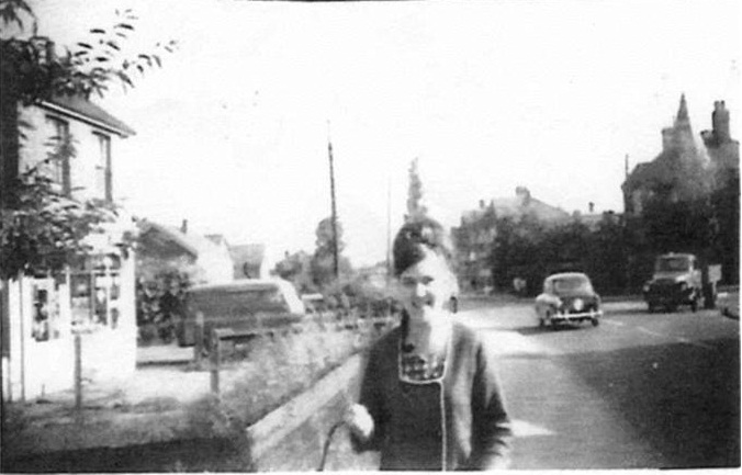 "Me in Laindon High Road, in 1964, with the ""Hiawatha"" at the junction with St. Nicholas Lane in the background on the right."