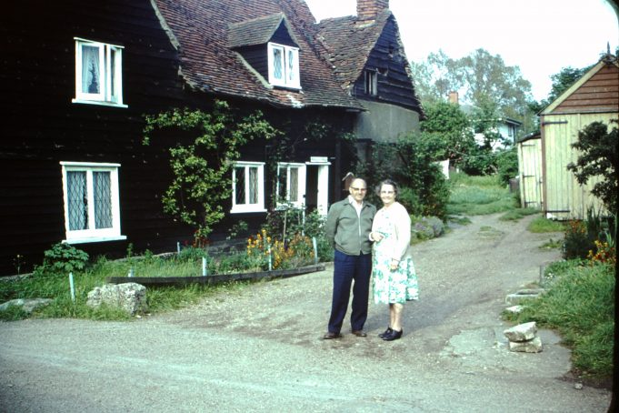 Ernie and his sister in front of 'Smugglers Cottages', West Mersea, during his 1964 visit. | Kristen den Hartog